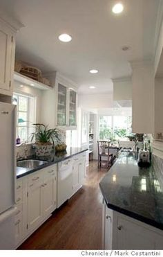 Small but elegant galley kitchen - this layout leading to a breakfast nook is very similar to the one in our house.