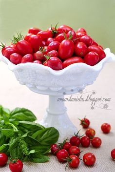 I picked my first Cherry Red tomato today!  I hope my bowl with soon flow over like this!