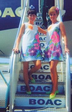 """BOAC got into flower power in 1967 by kitting their airhostesses in these floral """"paper dresses"""" on Caribbean flights, where passengers would be served rum swizzles in beakers with umbrellas, as well as given fruit and flowers and floral slippers."""