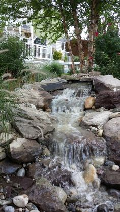 Pondless waterfeature with landscape lighting and adjustable flow pump 4000-8000 gph.