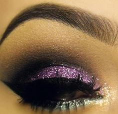 White, metal, and purple glittery shadows with black in the outer crease.