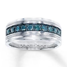Jamie's Wedding Ring - Round Artistry Blue Diamonds® flow across a band of sterling silver in this attractive ring for him. The ring has a total diamond weight of 1/2 carat. Artistry Blue Diamonds® are treated to permanently create the intense blue color. Diamond Total Carat Weight may range from .45 - .57 carats.