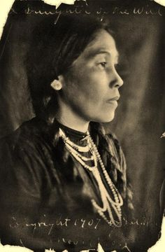 1907 photo titled Daughter of the Wild - Head-and-shoulders portrait, facing right, of Native American woman.