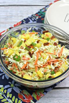You need to make this delicious Pineapple Coleslaw if you are throwing a Luau (and even if you're not!). A sweet tangy dressing covers the crunchy slaw mix of cabbage, broccoli, carrots, fresh pineapple, and crumbled bacon making it a wonderful side dish for barbecued meats. #PineappleColeslaw #LuauPartyFood #ThePurplePumpkinBlog #Recipes #LuauRecipes #HawaiianRecipes Winter Salad Recipes, Healthy Salad Recipes, Pineapple Coleslaw, Side Dishes For Chicken, Homemade Mashed Potatoes, Corn Dishes, Great Appetizers, How To Make Salad, Side Dish Recipes