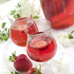 Berry Mimosa mocktail - cranberry juice, raspberry ginger ale, strawberries and mint