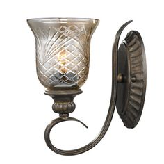 Scrolling burnt sienna-finished wall sconce with a hand-cut heirloom crystal glass shade.     Product: Wall sconce   Co...