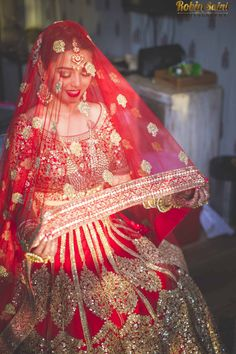 We can't stop gushing over this pretty bride and her beautiful red lehenga. Breathtaking!
