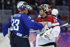 DAY 12:  Robert Kristan #33 of Slovenia and Mathias Lange #24 of Austria after the Ice Hockey Men's Playoff Qualification - Austria vs. Slovenia http://sports.yahoo.com/olympics