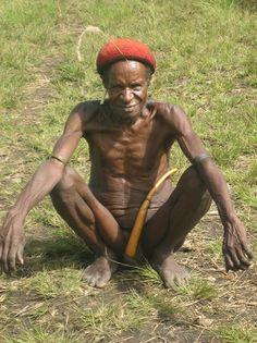 West Papua (Irian Jaya) | A Dani tribesman wearing a Koteka or penis gourd.  Baliem Valley | ©Elisa Kotin