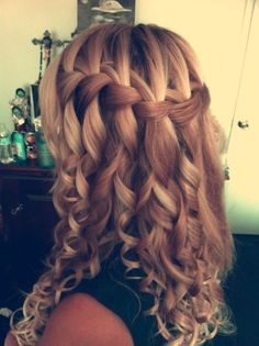 Waterfall braid with tight curls. This is gorgeous!