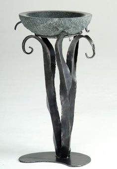 hand forged iron & stone. Beautiful!  (Maybe we could make a slumped bowl for the beautiful iron stand)