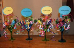 """Getting old sucks - birthday table decorations/party favors. I used plastic martini glasses, curling ribbons and a variety of suckers.  Then added a topper that says """"getting old sucks"""" and on the back you can put the age you are celebrating."""