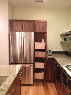 Tall pantry pull out shelving. Designed by Kitchen Planners in Rockville, MD