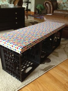 Plastic crates ...so versatile! Use a vinyl tablecloth to cover cushion, so easy to clean and pack some camping gear in the crates. Empty crates, once there, and turn into bench.
