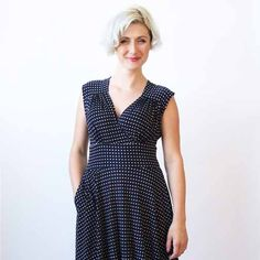 This dress with pockets has a small shoulder cap sleeve. the v neck dress also has a gathered, pleated back bodice. the full flared skirt is knee length and has a waistband. machine wash cool, hang dry, no ironing ever needed! the nora is an american made dress crafted with love in Brooklyn, NY