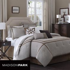 This Easton comforter set from Madison Park creates a sleek, modern look in any bedroom. This 7-piece bedding set features neutral tones in a brown border.