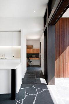 Nice modern space and mix of materials. Terrific texture from that stone flooring.