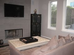 Our redone family room!  Gray slate fireplace