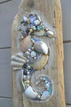 Driftwood Seahorse Wall Hanging using shells and pearls, Handmade in Cornwall. Something like this would look good applied directly to a fence postToo cool on driftwood, seahorse bling!This lovely driftwood wall hanging is made using reclaimed driftw Driftwood Seahorse, Seashell Art, Seashell Crafts, Driftwood Art, Seahorse Art, Driftwood Wreath, Driftwood Projects, Driftwood Ideas, Deco Nature