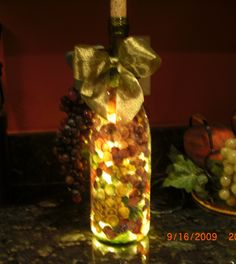 Handmade Lighted Wine Bottle With GRAPES - Great Gift - Beautiful. $20.00, via Etsy.