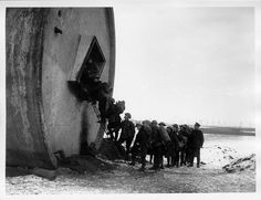 Gunners of the 51st Division Entering their billet in an overthrown water-tower. Item date	 5th January 1918| First World War Poetry Digital Archive