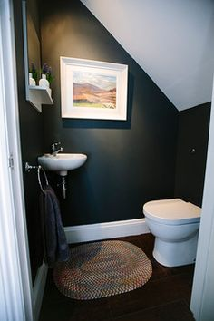 Brilliant Under-Stairs Toilet Ideas (+ Things To Consider First) We have seen so many cool toilets under stairs, that we thought it was time to allocate a post to … Small Downstairs Toilet, Small Toilet Room, Downstairs Cloakroom, Cloakroom Toilet Small, Guest Toilet, Tiny Bathrooms, Small Bathroom, Bathroom Ideas, Bathroom Black