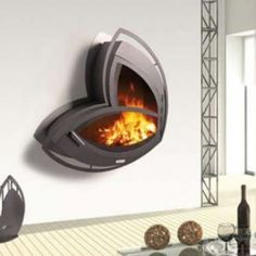 New takes on the traditional fireplace for indoors and outdoors. Found on Trend Hunter. LOVE!!!