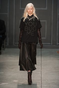 """Vera Wang Gives Us the Chicest Goth Possible: Vera Wang is about the last designer we would imagine sending out a slogan tee, but there it was on her Fall 2014 runway: the chicest black-and-gray tee with """"You Bug Me"""" on the front and a cicada on the back."""