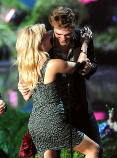 Look Back at Highlights From the MTV Movie Awards: Reese Witherspoon hugged Robert Pattinson after receiving her award in 2011.