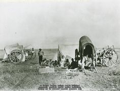 Western plains Métis family camp and Red River Carts, names, date and location unknown. THE VIRTUAL MUSEUM OF MÉTIS HISTORY AND CULTURE.
