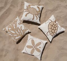 Our beautiful coastal hand beaded pillows add flair to any bedroom or living room. #Coastal #Pillows