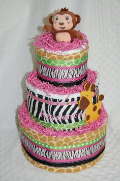 Animal baby shower cake    I'm thinking less frills and pink and white zebra instead of black though