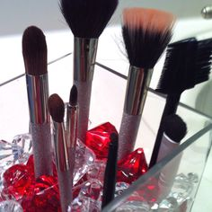 Make up brushes+glass container+big plastic jewels=cute way to keep brushed organized and on display