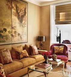 Below a Japanese screen in the media room is a sofa by Jasper covered in a Rose Tarlow fabric.