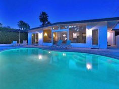 Palm Springs house rental - Pool and back of house night. Walls of windows facing west to the mountain view.