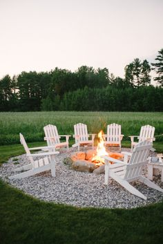 Adirondack chairs by the fire pit at sunset.