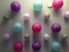 Baby room decor: hang different colored chinese lanterns on the ceiling to add color to a room you cannot paint