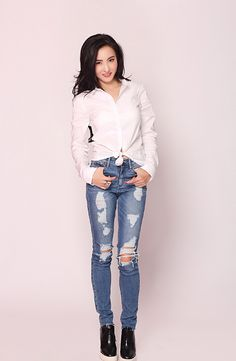 HK star Cecilia Cheung in white knotted shirt, distressed jeans, and platform shoes.