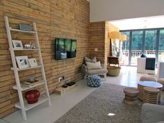 My timber clad wall using old wooden pallets, adds warmth and texture to the living space.