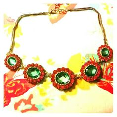 Pink and aqua rhinestone necklace Rhinestone necklace with gold tone chain and pink and aqua stones. Jewelry Necklaces