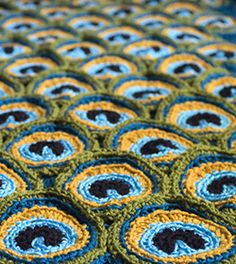 I love the brilliant colours of peacock feathers and their amazing, almost hypnotic pattern. This blanket is an attempt to try and capture some of that mesmerizing beauty. Reversible and double-thick, it's also a great blanket to cozy up in or to use as a bedspread.