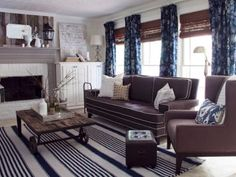 Country Living Room With Blue Accents, Brown Furniture and Fireplace