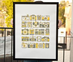 I'm sure this could be used to direct guests to the photo booth! Retro Camera Poster by Fifty Five Hi s