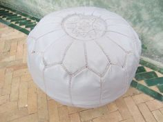 Pale grey pouf