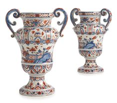 A PAIR OF DUTCH DELFT POLYCHROME BALUSTER VASES 1691-1721, Lambertus van Eenhoorn, De Metale Pot factory, each painted on the front and reverse with branches of oriental flowers issuing from rockwork within a fenced garden between floral and foliate borders around the neck and shoulder and lappet borders around the lower body and foot, affixed on either side with a scroll handle, VE 2 4 monogram mark in blue. height 12 7/8 in. 32.7 cm Estimate  20,000 — 30,000  USD  LOT SOLD. 25,000 USD