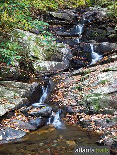 Hike the Gahuti Trail at Fort Mountain State Park to the Goldmine Branch Falls waterfall near Ellijay, Georgia