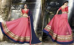 Look beautiful and yet stunning with the elegant and vibrant color combination of peach and navy blue featured on a net #LehengaCholi.