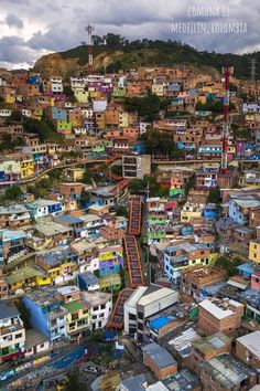 Comuna 13 in Medellín, Colombia. How Medellín,Colombia's most notorious & dangerous area,Comuna 13 Medellin, reinvented itself from drug and gang wars. Visit Colombia, Colombia Travel, Best Places To Live, Places To Travel, Places To Visit, Columbia Medellin, Harbor City, South America Travel, Slums