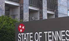 Tennessee's state bird perches in an appropriate spot, right above the State of Tennessee sign at a downtown state office building Downtown Chattanooga, State Of Tennessee, State Birds, Great Smoky Mountains, Mississippi, Country Music, Sign, Building, Sweet
