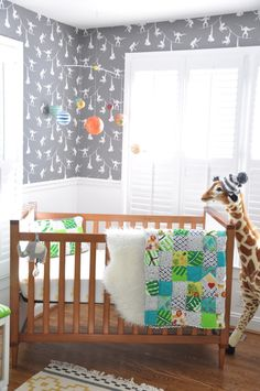 Love this @Anthrolopologie wallpaper in this Modern Safari Nursery!